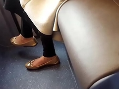 Flashing feet in bus