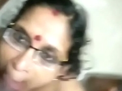 Mature mallu mom giving oral-service with the addition of taking jism in mouth